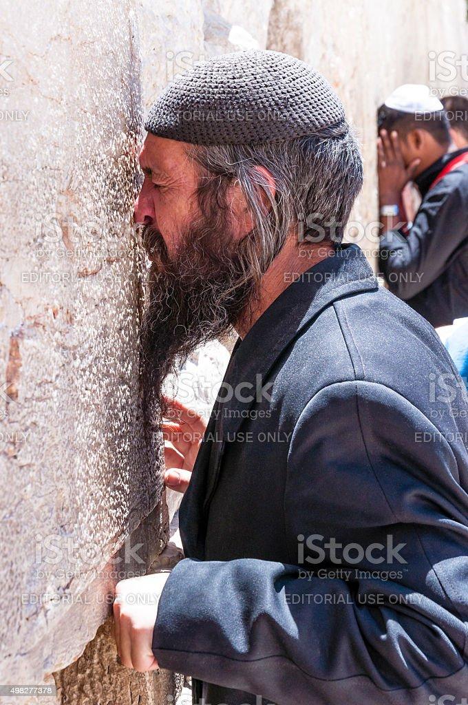 Jewish Orthodox praying near the Western Wall in Jerusalem, Israel stock photo