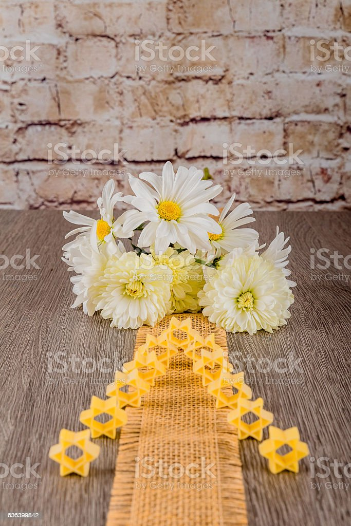 Jewish pasta for broth , a background of white flowers stock photo