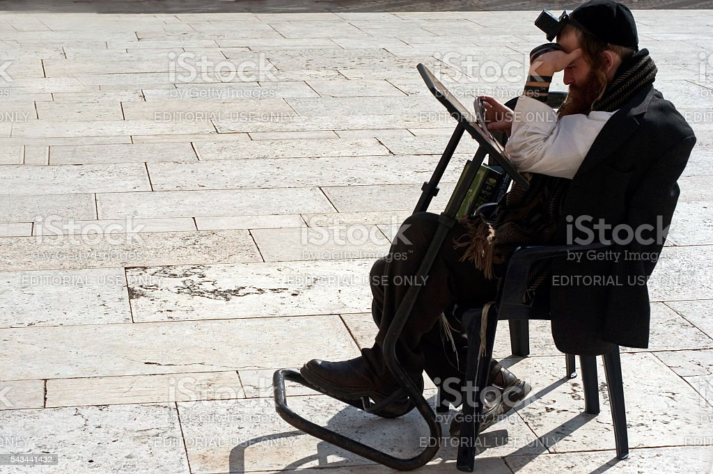 Jewish pray at the Western Wall in Jerusalem Israel stock photo