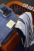 Jewish rabbi reads Torah
