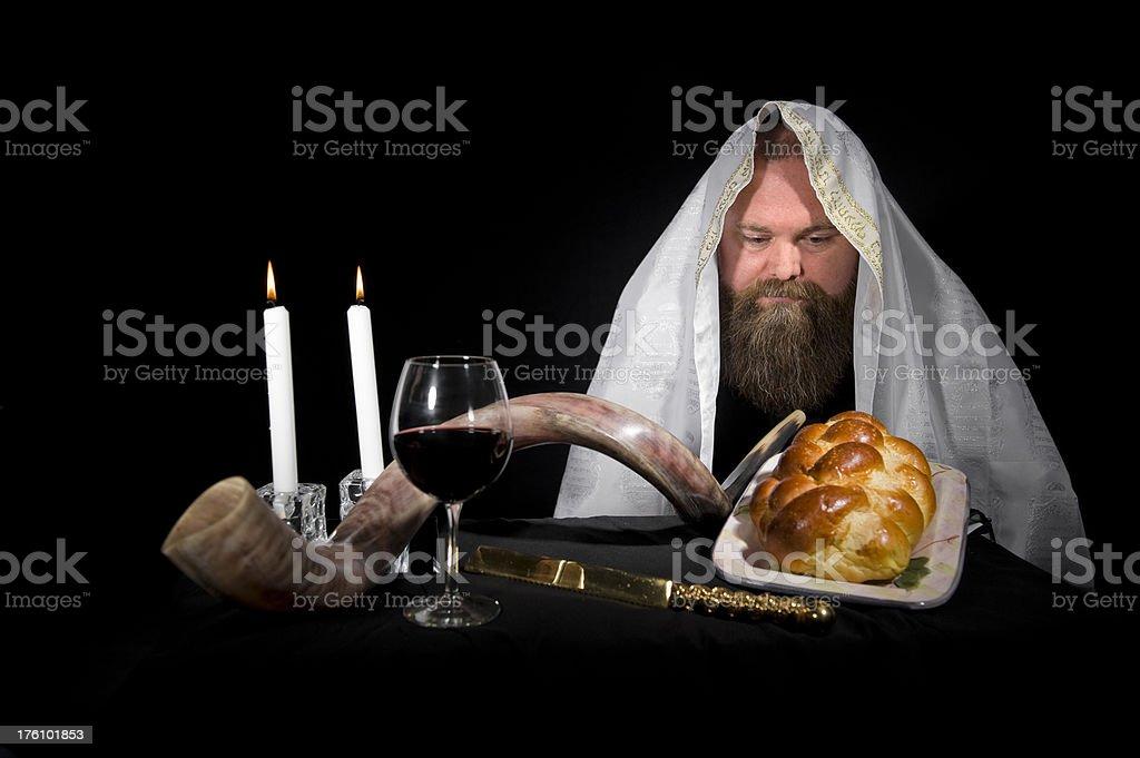 Jewish Rabbi Wearing Tallit Looking at Challah stock photo