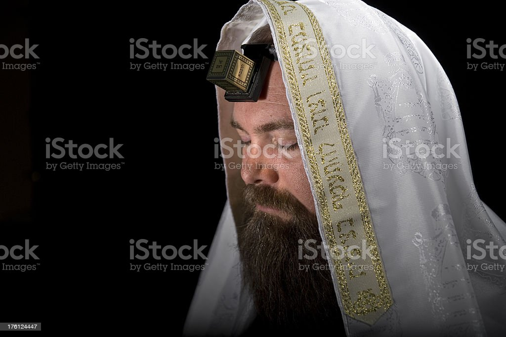 Jewish Rabbi Wearing Tefillin  in Prayer stock photo