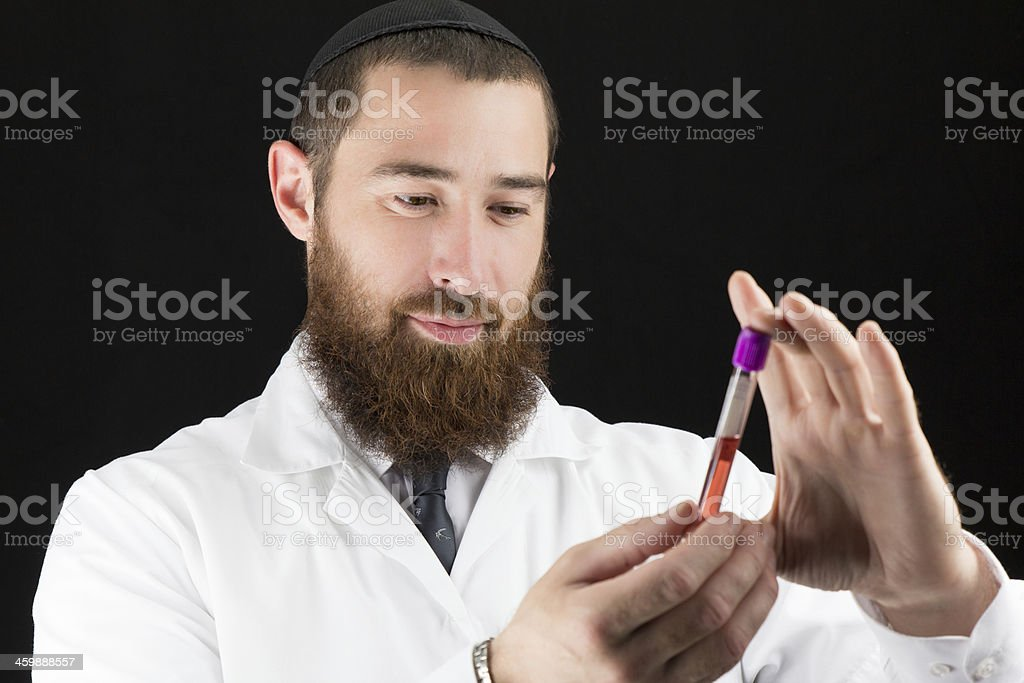 Jewish Religious Doctor Holding a Blood Test stock photo