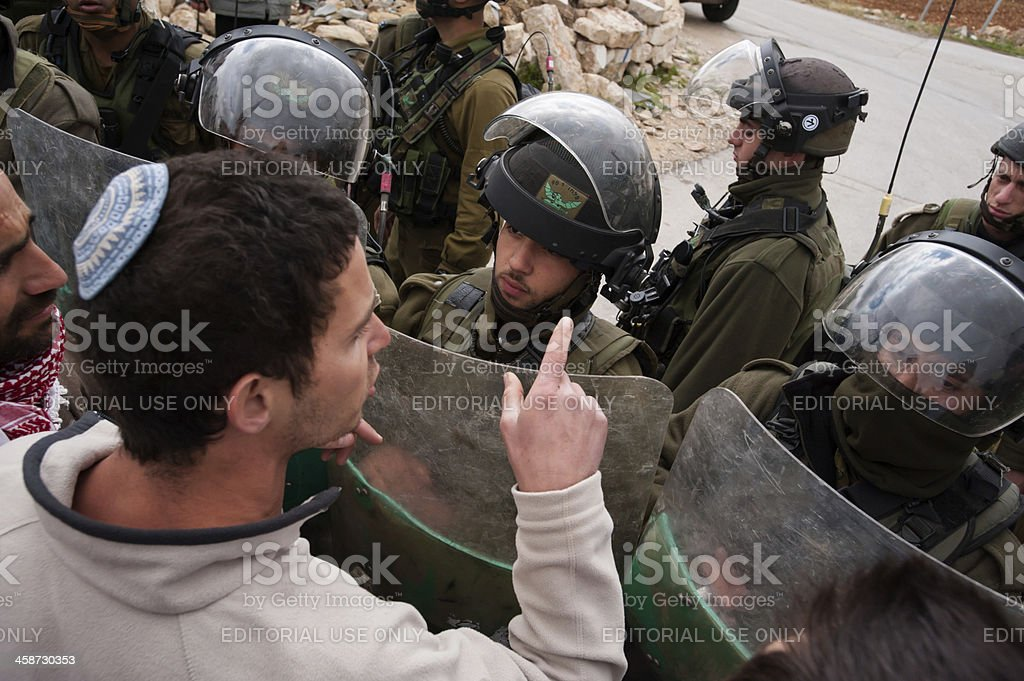 Jewish solidarity activist confronts Israeli soldiers stock photo