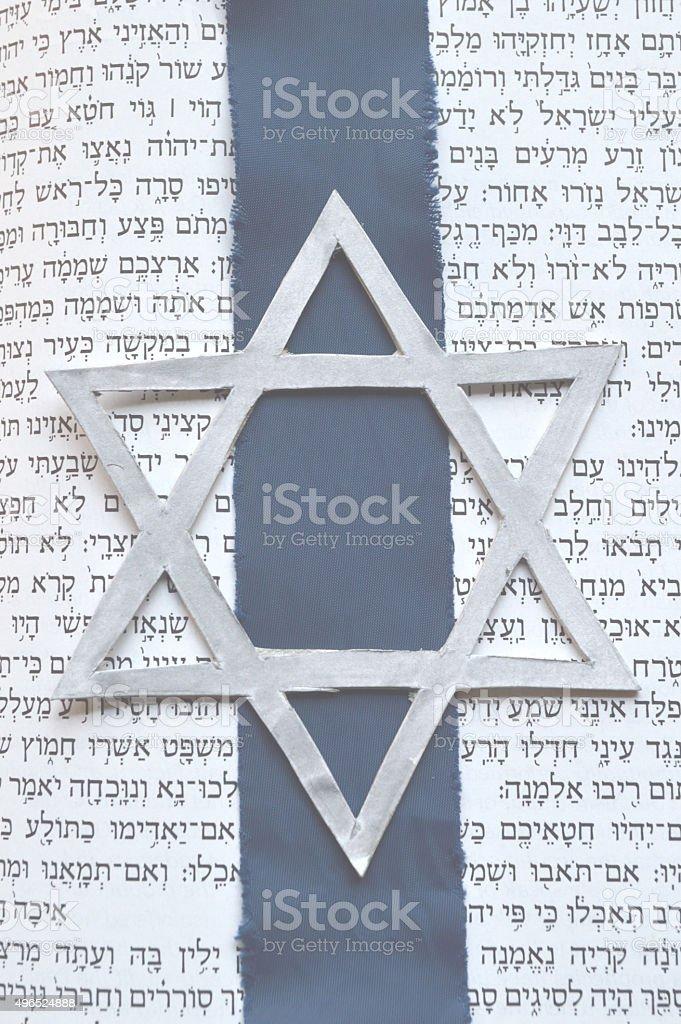 Jewish Star of David with Tanach background stock photo