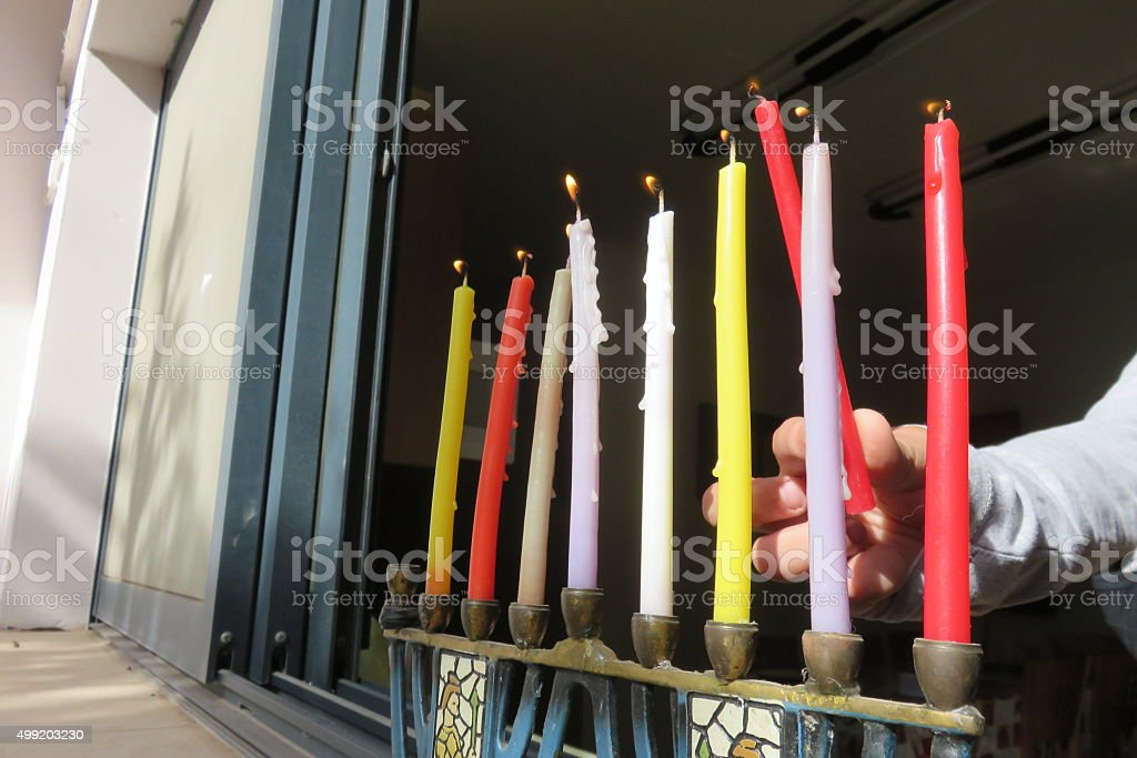 Jewish tradition, Chanukah Candle Lighting in the window stock photo