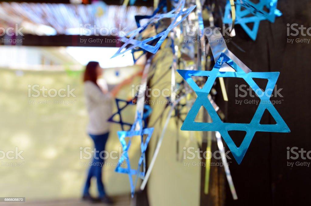 Jewish woman decorating here family Sukkah stock photo