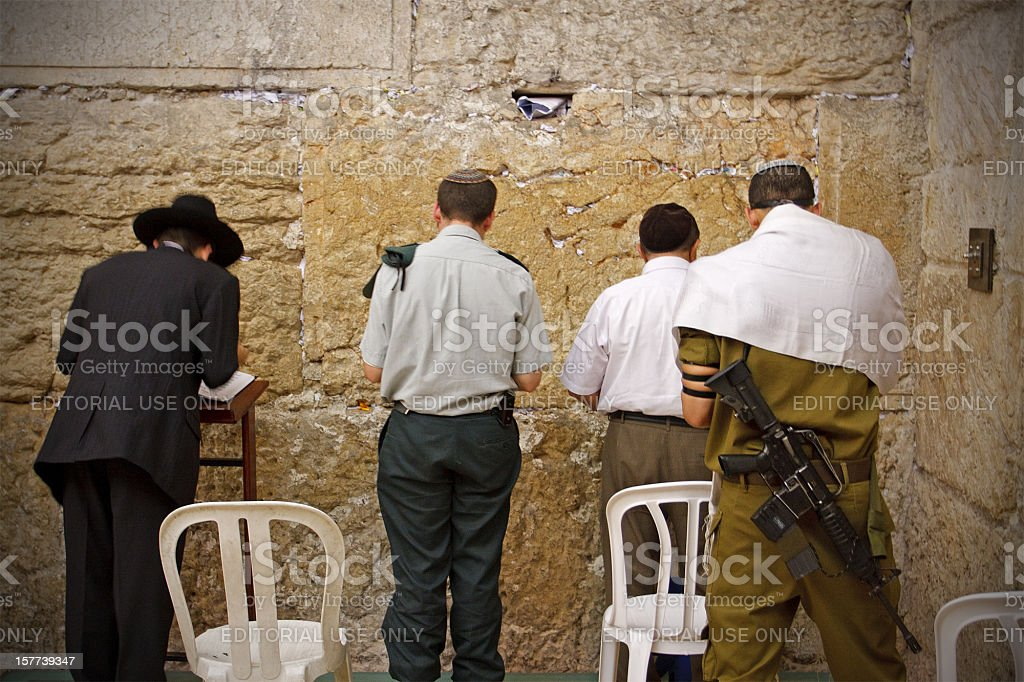 Jews, solders, all praying at the Western Wall stock photo