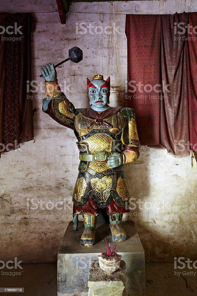 jiangxi, china: statue of an underworld magistrate stock photo