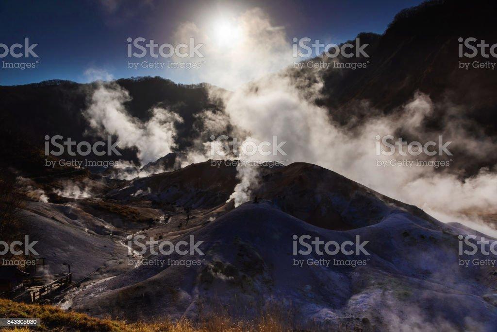 Jigokudani hell valley against sunrise and blue sky in Noboribetsu stock photo