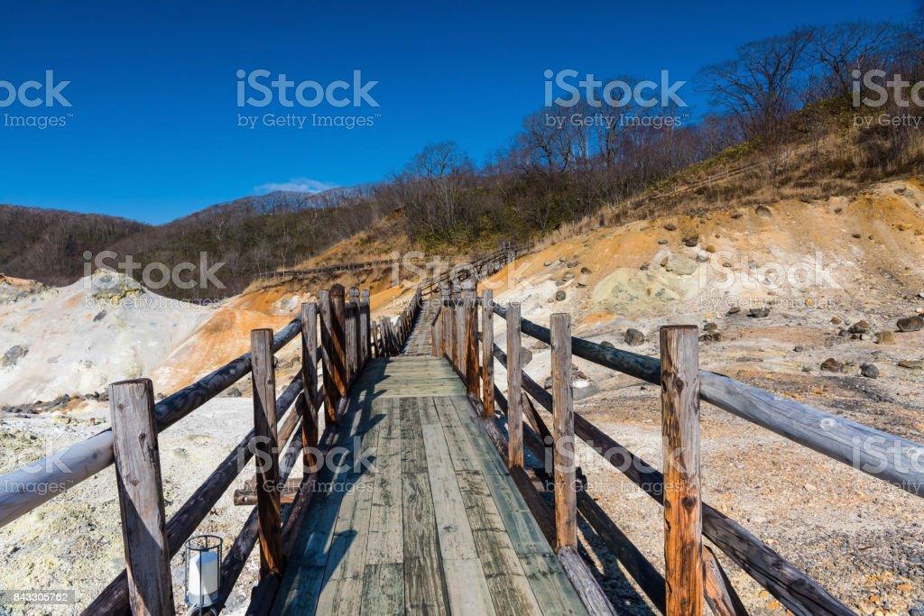 Jigokudani hell valley walking path against blue sky, Noboribetsu stock photo