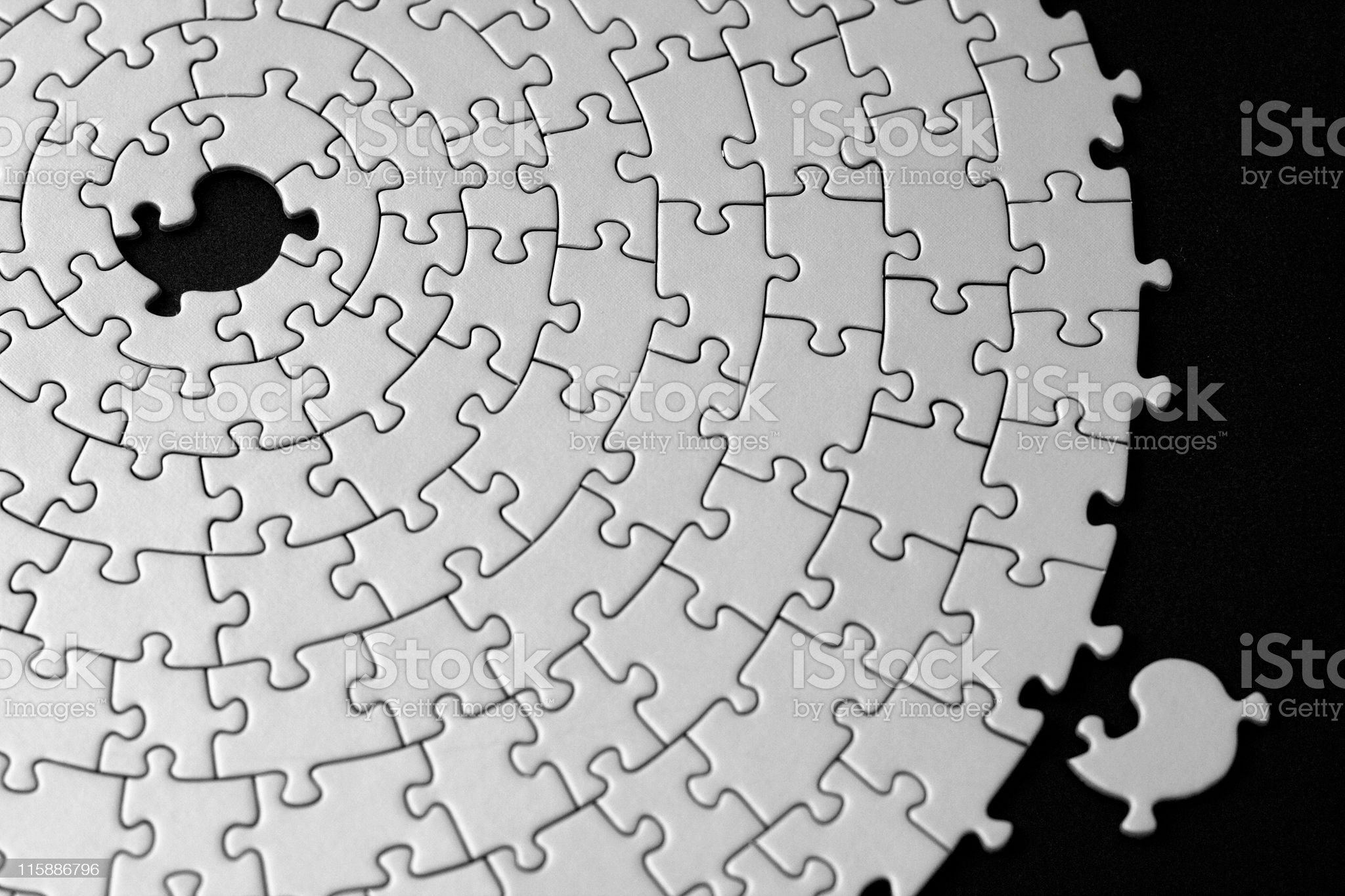 jigsaw in black and white with one missing piece royalty-free stock photo