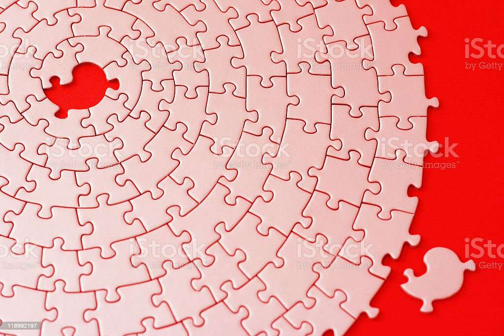 jigsaw in red and pink with one missing piece royalty-free stock photo