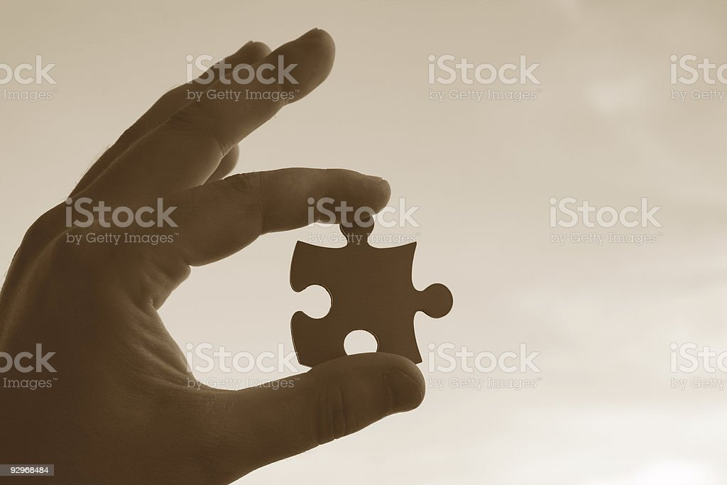 Jigsaw in your hand royalty-free stock photo