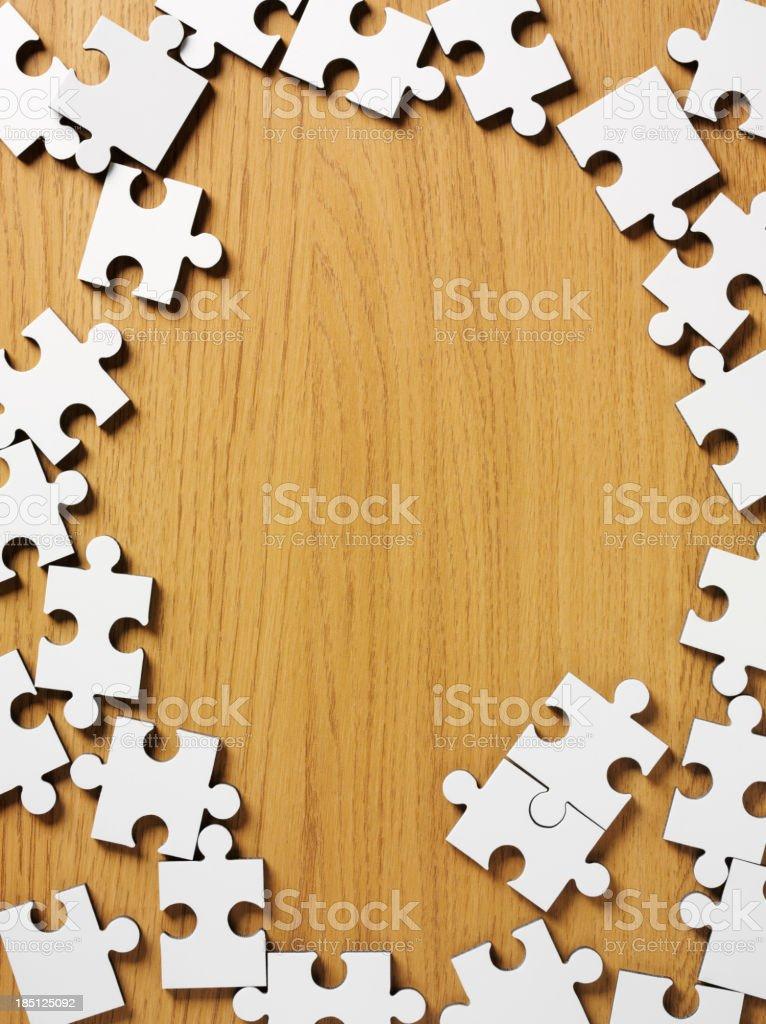 Jigsaw Puzzle Frame on Wood stock photo
