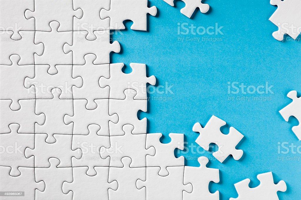 Jigsaw Puzzle on Blue stock photo