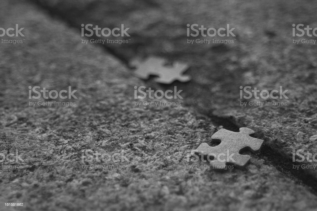 Jigsaw puzzle on ground royalty-free stock photo