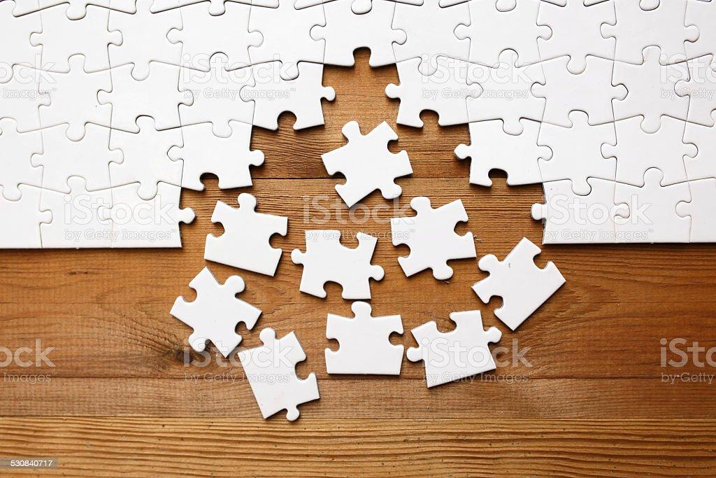 Jigsaw puzzle on wood stock photo