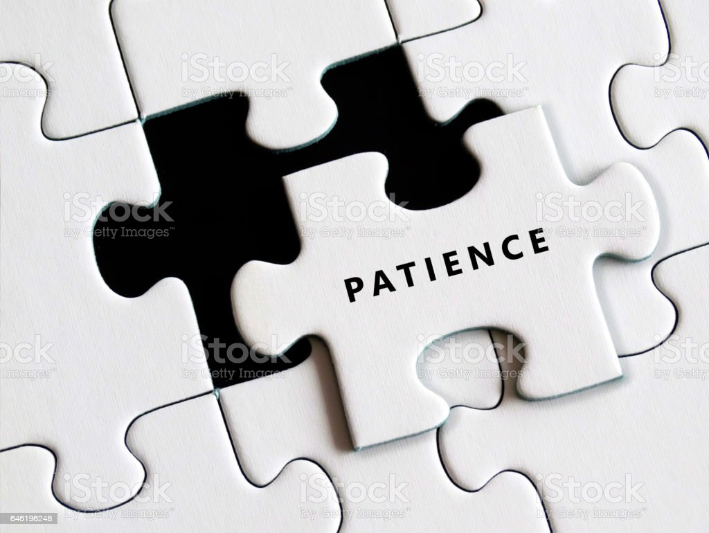 Jigsaw puzzle patience and perseverance concept stock photo