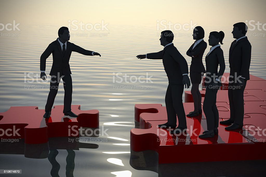 Jigsaw puzzle recruiting new staff at sunrise on water. stock photo