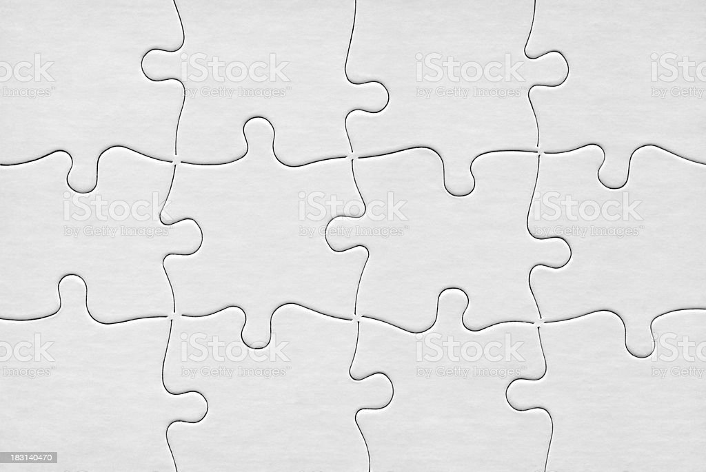 Jigsaw Puzzle With Twelve Blank White Pieces stock photo