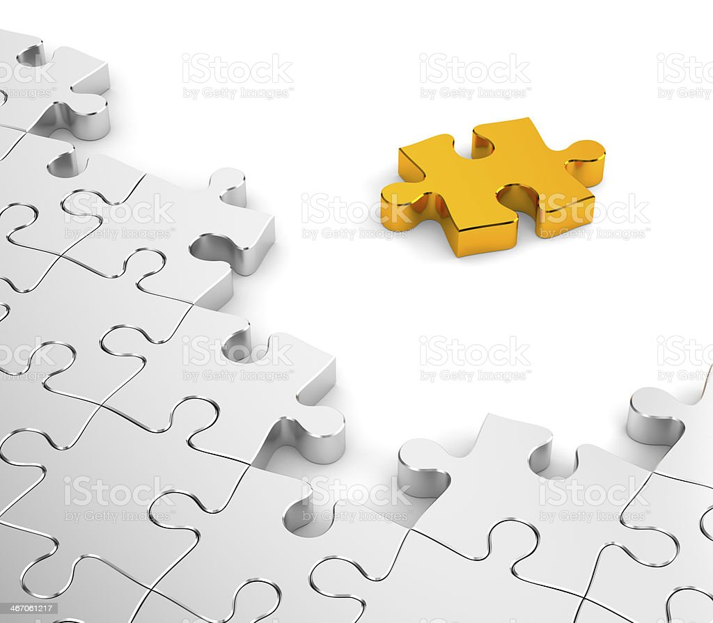 Jigsaw puzzles in gold and chrome royalty-free stock photo