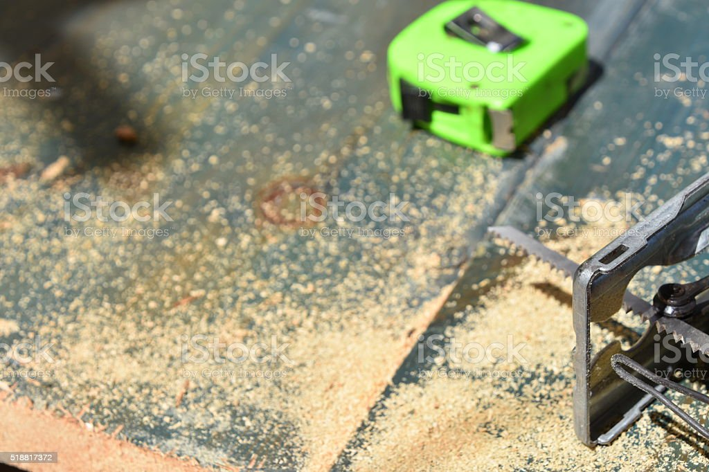 Jigsaw,Sawdust and measuring meter stock photo