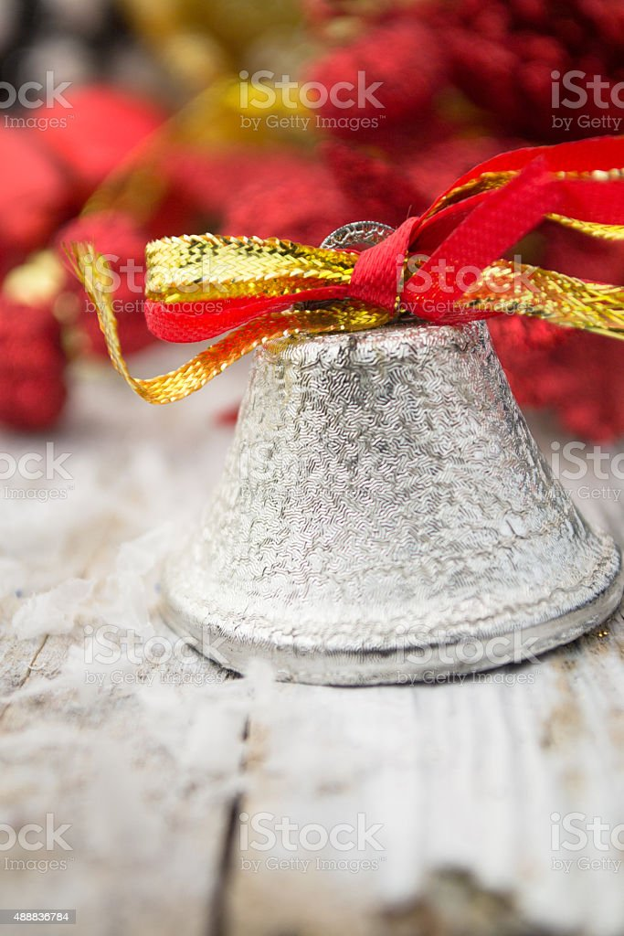 Jingle bell on wooden surface with copy space stock photo