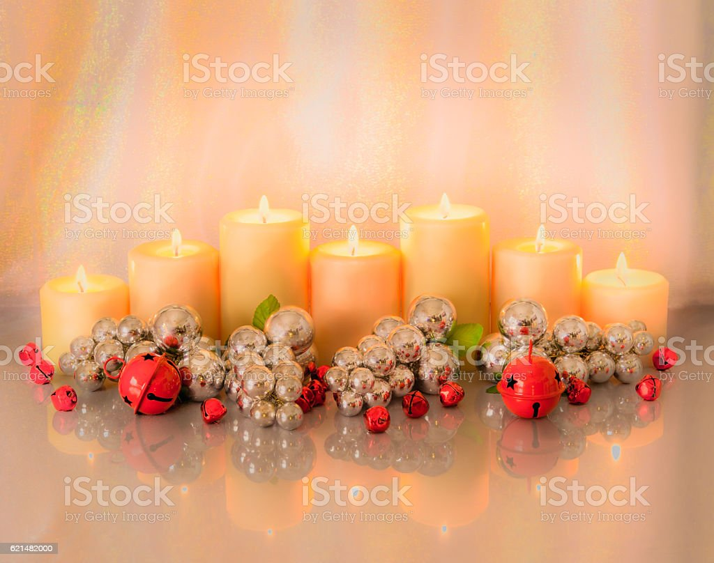 Jingle bells and candles with Christmas Decorations Glow (P) stock photo