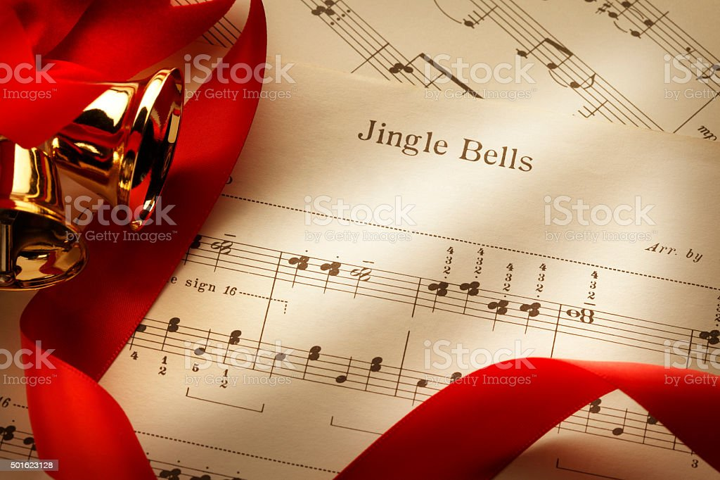 Jingle Bells Sheet Music With Red Ribbon And Bells stock photo