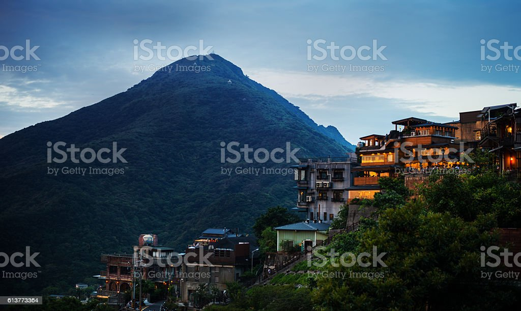 Jiufen village in front of mountain stock photo