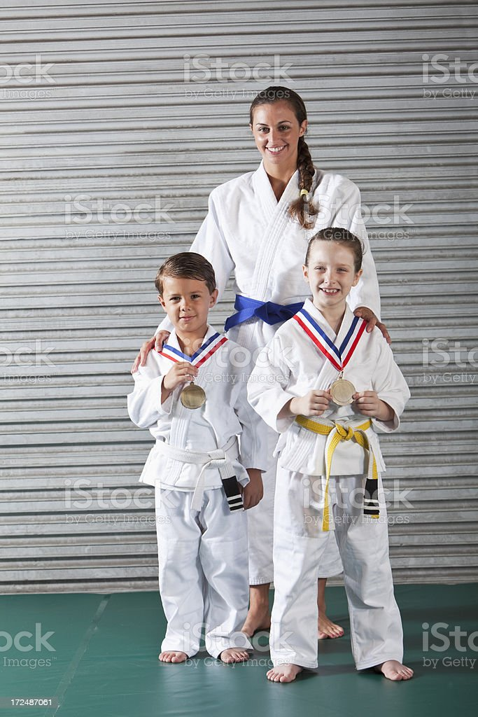 Jiu-Jitsu instructor and children with medals royalty-free stock photo