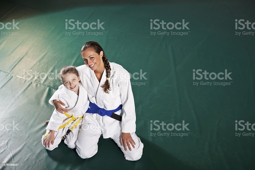 Jiu-Jitsu instructor with student royalty-free stock photo