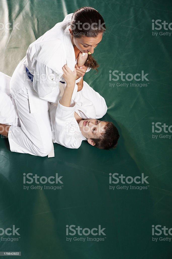 Jiu-Jitsu Key armbar from mount stock photo