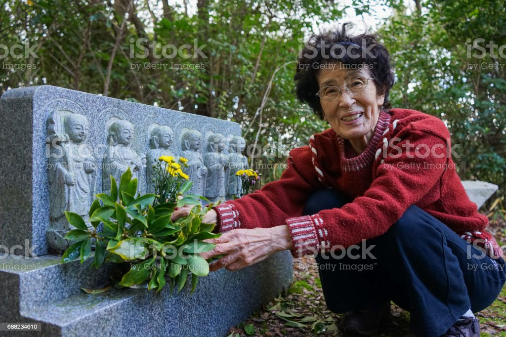 Jizo and grandmother stock photo