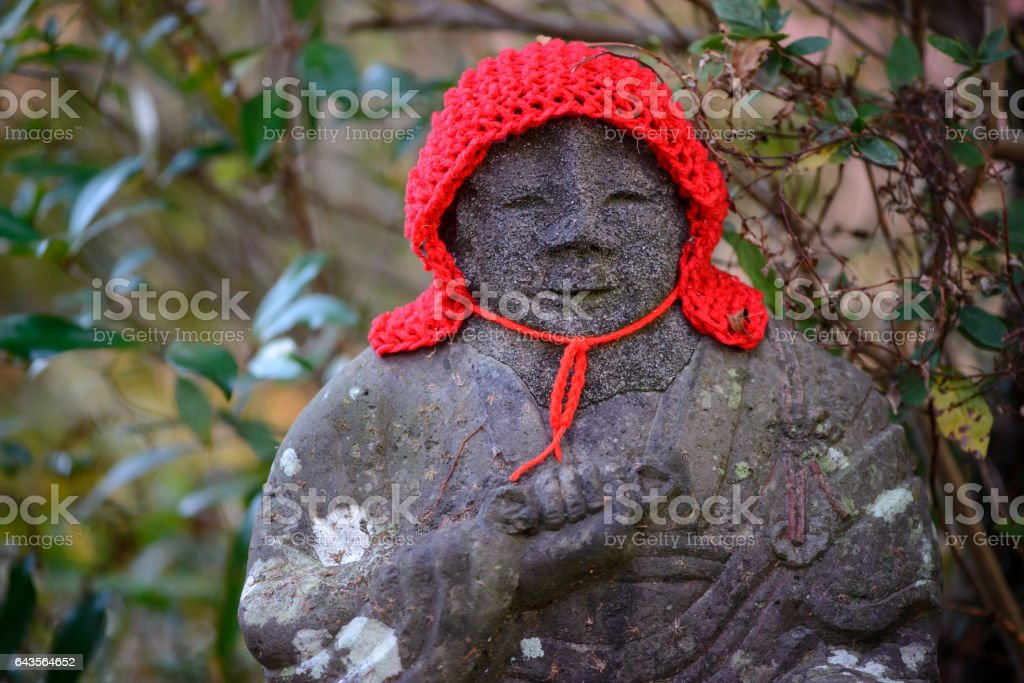 Jizo Bosatsu with a red woolen cap stock photo
