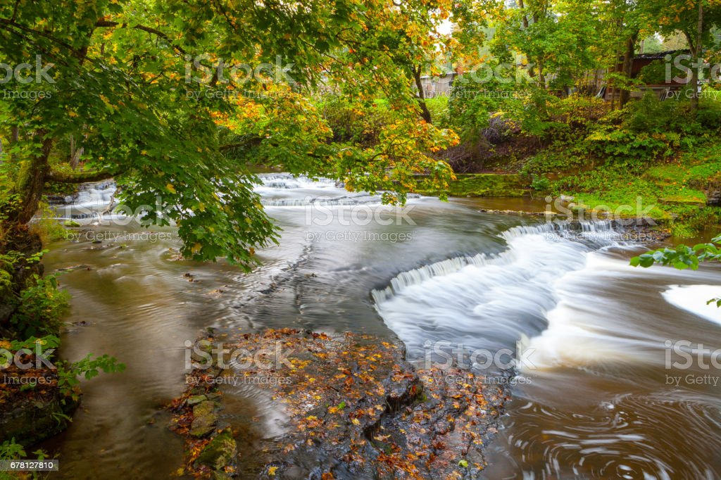 Joaveski waterfall on the river, with leaves, in Estonia stock photo