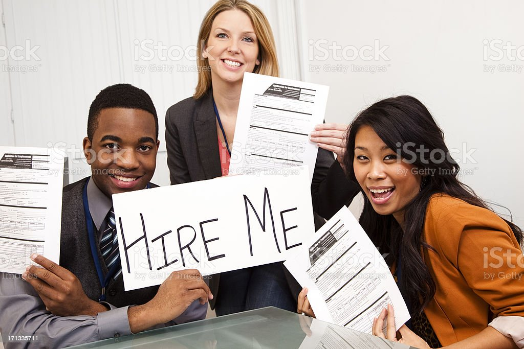 Job applicants holding applications and hire me sign royalty-free stock photo