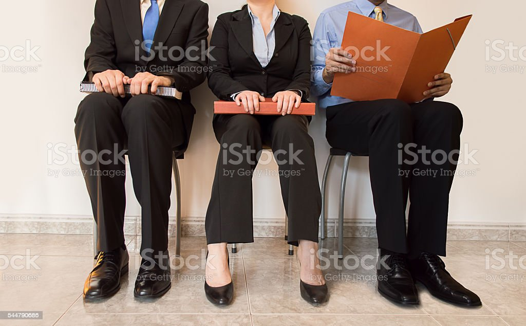 job applicants sitting stock photo