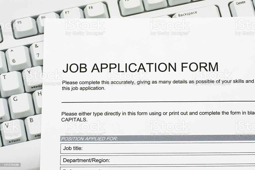 Job application form on top of keyboard royalty-free stock photo