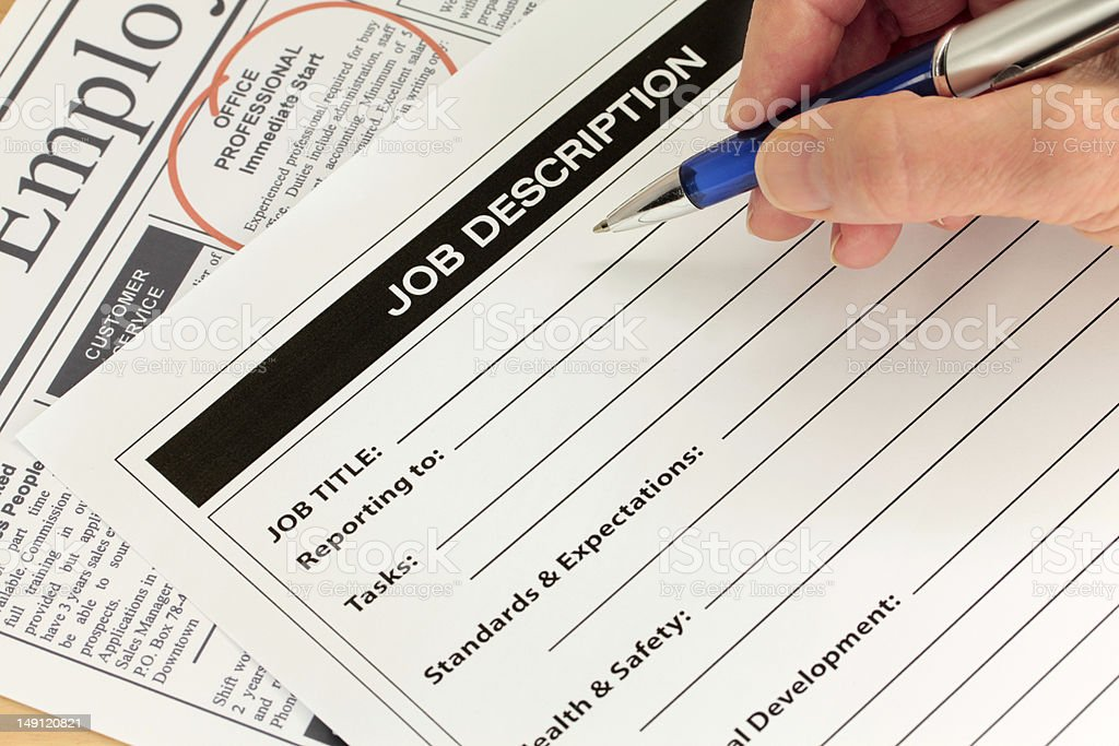 Job Description and Hand with Pen stock photo