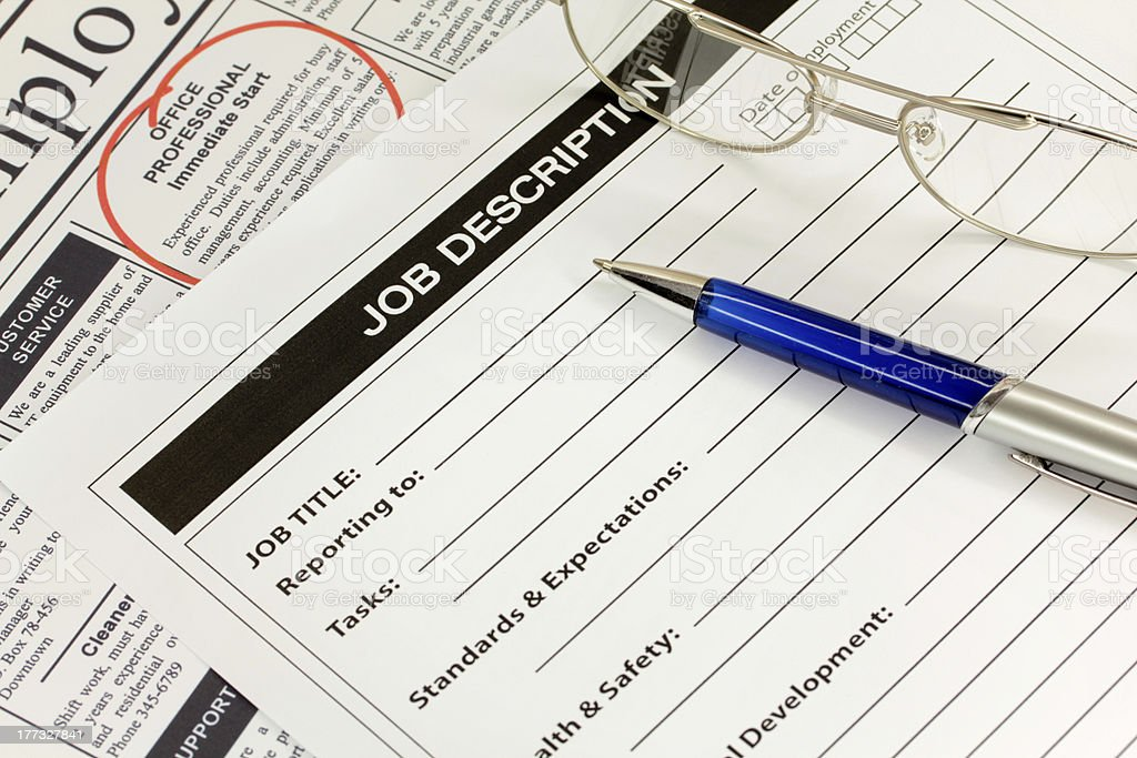 Job Description with Pen and Spectacles stock photo