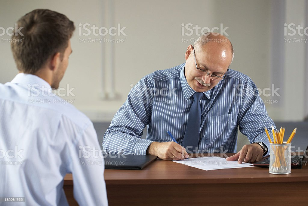 job interview, senior manager and young apprentice isolated on white royalty-free stock photo