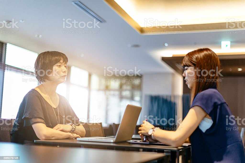 Job interview with senior manager in Japanese corporation stock photo