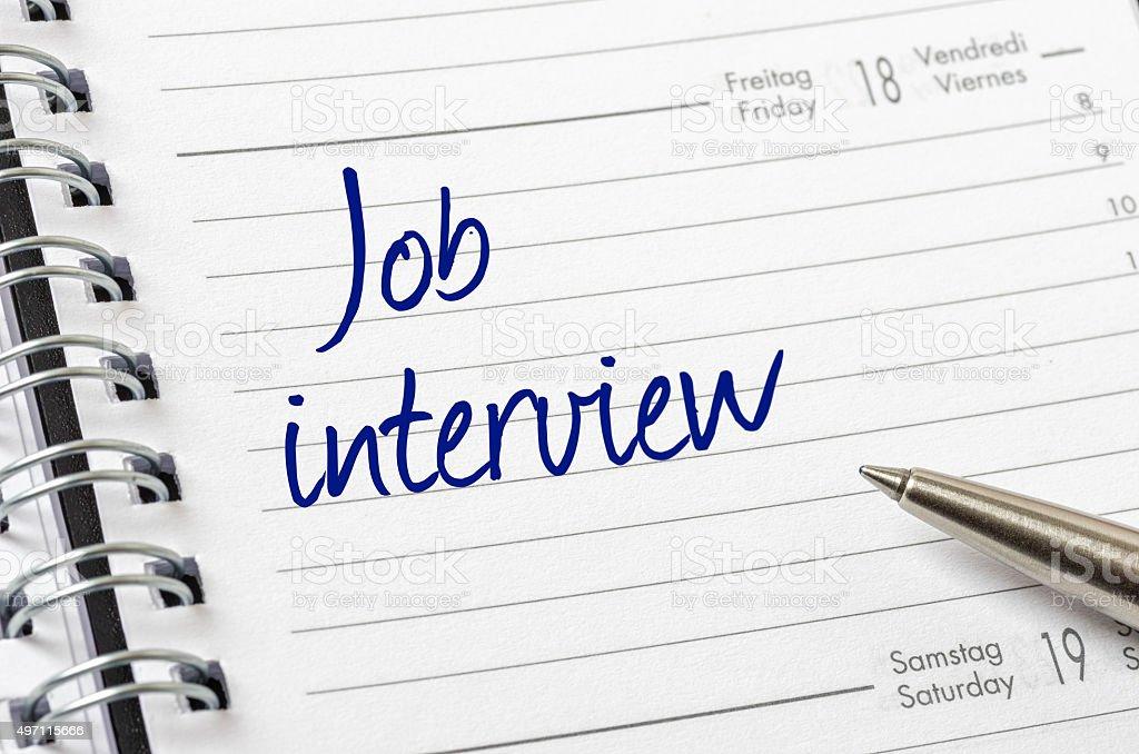 Job interview written on a calendar page stock photo