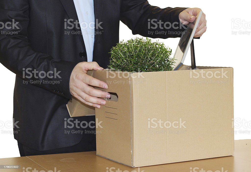 Jobless employee pack his personal belongings stock photo