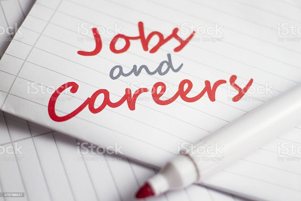 Jobs and Careers handwritten on notebook paper stock photo