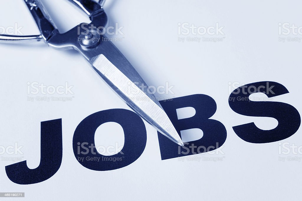 Jobs written in bold with scissors resting on top stock photo