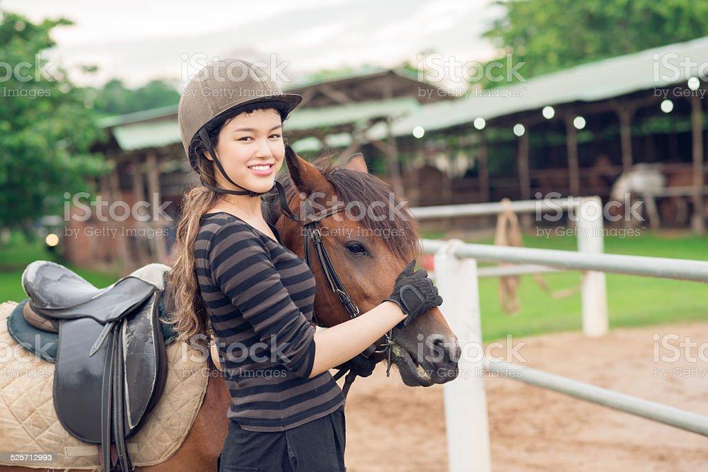 Jockey girl and her horse stock photo