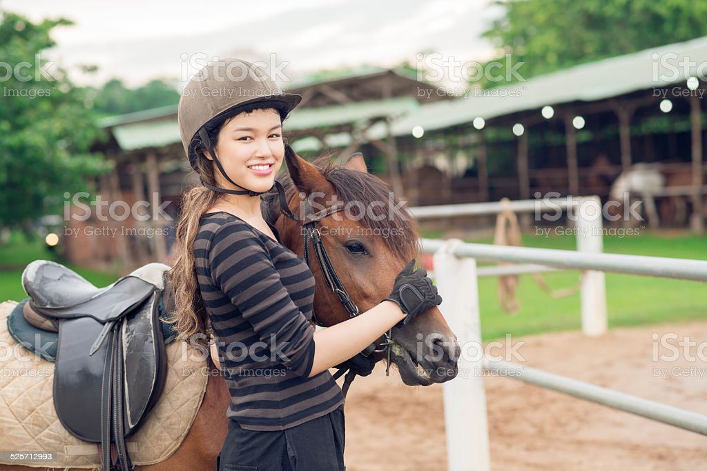 Jockey girl and her horse stock photo